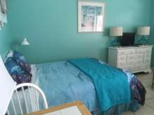 Double bed, bedding in shades of blue with dolphin print