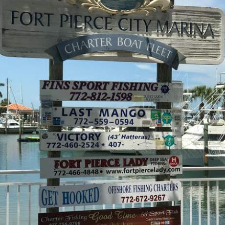 Fort Pierce directional signs for local establishments
