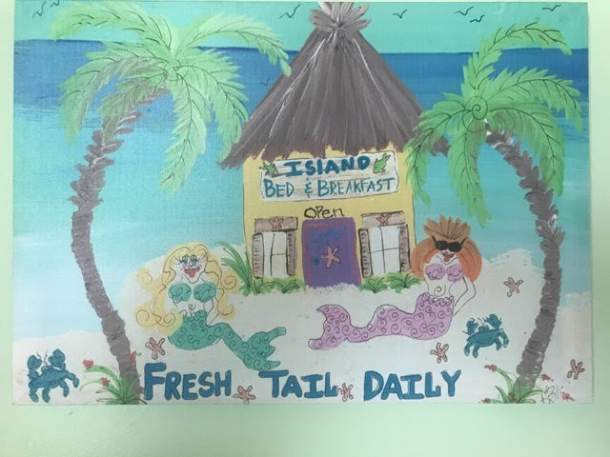 Painted sign that reads Island Bed and breakfast, fresh tail daily