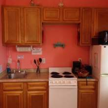 Kitchenette - oak cabinets, small stove, refrigerator, microwave