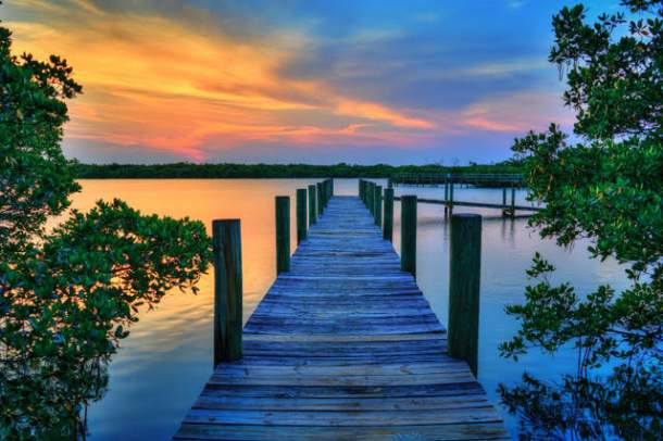 Wood dock on river, sunset